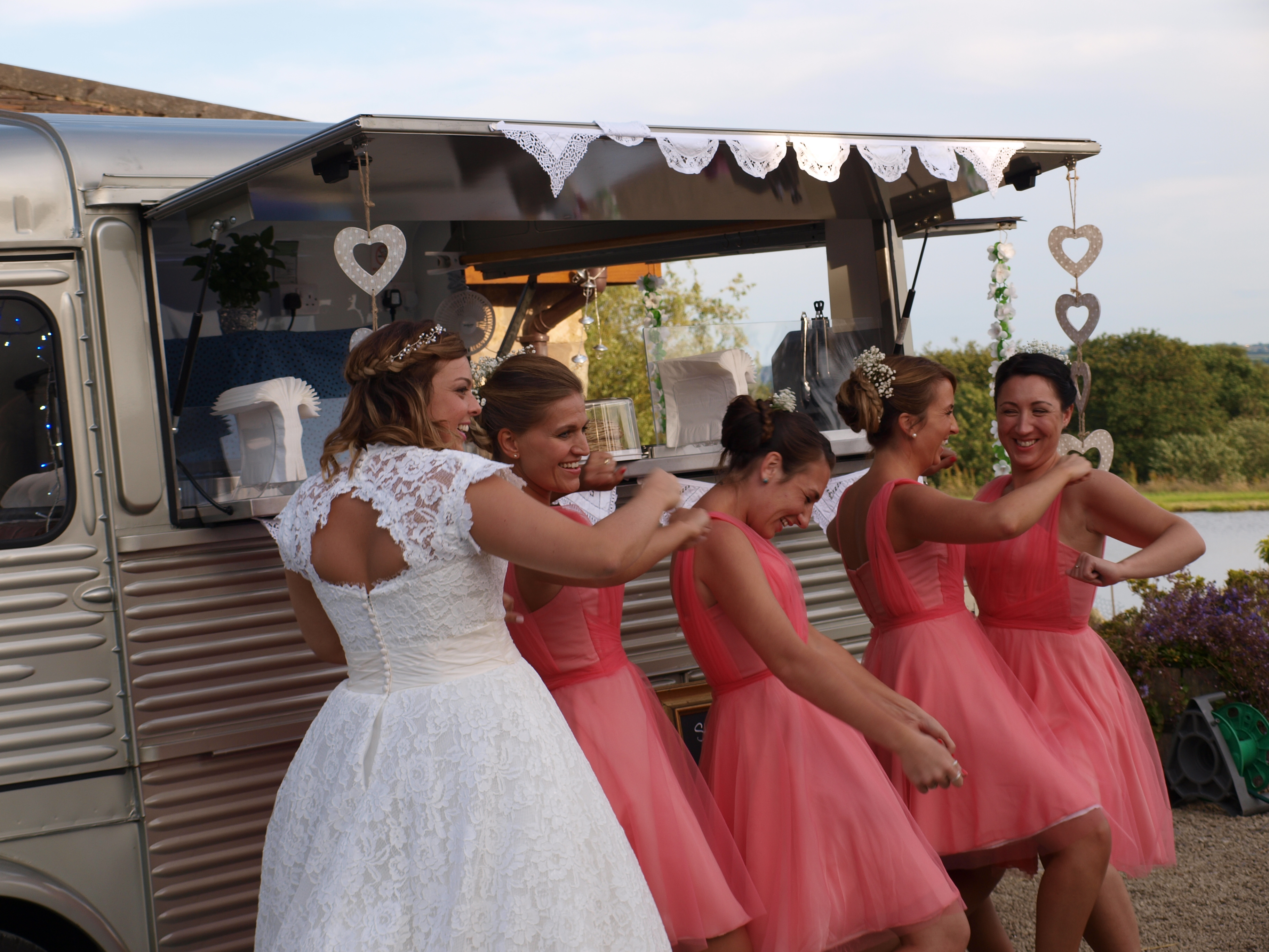 Bride & bridesmaids having fun at White Chimnies Cottages in Staffordshire moorland